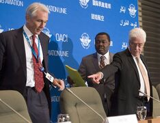 Tony Tyler, left, IATA ((International Air Transport Association) director general and CEO, Dr. Olumuyiwa Benard Aliu, center, president of ICAO (International Civil Aviation Organization), and Raymond Benjamin, right, ICAO Secretary General, arrive for a news conference, Tuesday, July 29, 2014 in Montreal.THE CANADIAN PRESS/Ryan Remiorz