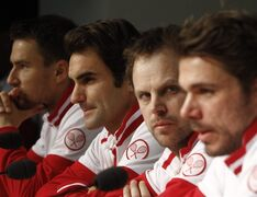 Switzerland's Roger Federer, second left, during the Swiss team media conference at the Pierre Mauroy stadium in Lille, northern France, Tuesday, Nov. 18, 2014. Switzerland will face France in the Davis Cup final starting next Friday. (AP Photo/Michel Spingler)