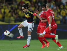 Colombia's Falcao Garcia, left, fights for the ball with Kuwait's Saleh Al Hendi, middle, during a friendly match in Abu Dhabi, United Arab Emirates, Monday, March 30, 2015. (AP Photo/Kamran Jebreili)