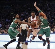 New York Knicks forward Cleanthony Early (17) drives to the basket against Boston Celtics forward Jae Crowder (99) and guard Evan Turner (11) during the first half of an NBA basketball game, Friday, March 27, 2015, at Madison Square Garden in New York. (AP Photo/Mary Altaffer)