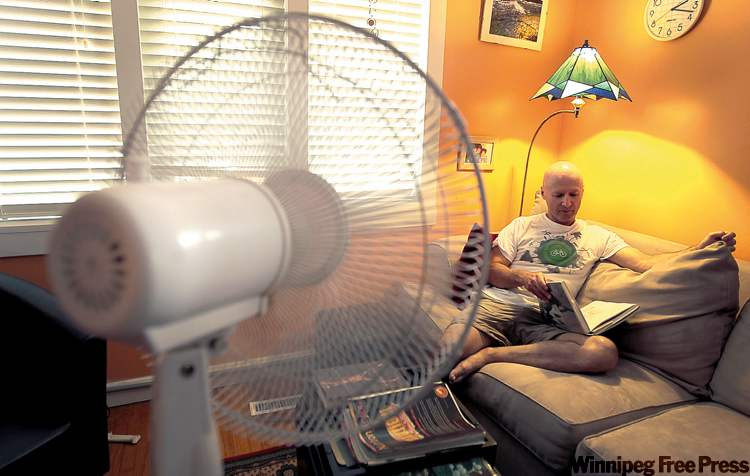 Curtis Hull of Climate Change Connection lowers the blinds, uses a fan and avoids cooking or using the clothes dryer until it cools off in the evening.