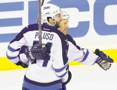 Winnipeg's Anthony Peluso has been showing some skills of late. Here he celebrates his goal against Nashville with Olli Jokinen.