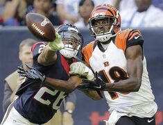 Houston Texans' Darryl Morris (26) breaks up a pass intended for Cincinnati Bengals' A.J. Green (18) during the fourth quarter of an NFL football game, Sunday, Nov. 23, 2014, in Houston. (AP Photo/Patric Schneider)