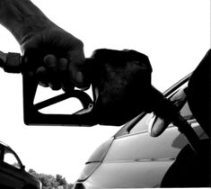 Seth Perlman / The Associated Press A motorist puts fuel in his car�s gas tank at a service station in Springfield, Ill.