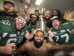Saskatchewan Roughriders celebrate after beating the Hamilton Tiger-Cats to win the Grey Cup on November 24, 2013 in Regina. The Roughriders were the only team to surpass the CFL's 4.4-million salary cap in 2013, the league announced Wednesday. THE CANADIAN PRESS/Frank Gunn