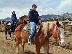 In this photo taken on Monday, April 21, 2014, tourist Christian Styles, right, and Katy Little, left, both of Des Moines, Iowa, ride at Sombrero Ranches riding stables in Estes Park, Colo. Styles is on Joker, a Belgian draft horse, while Little rides Dodge, a quarter horse. The outfit uses draft horses along with quarter horses for tourists. The bigger horses are better able to handle the mountainous terrain as well as heavy riders. Stables across the West are employing more of the larger draft horses to accommodate people who have gotten heavier in recent years. (AP Photo/P Solomon Banda)