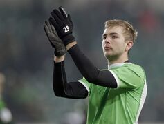 FILE - In this Nov. 30, 3014 file picture Moenchengladbach's Christoph Kramer applauds after the German Bundesliga soccer match between VfL Wolfsburg and Borussia Moenchengladbach in Wolfsburg, Germany. Bayer Leverkusen says Monday Dec. 22, 2014 Germany midfielder Christoph Kramer will return to the club next season and also has signed a two-year contract extension through 2019. Kramer is currently on loan at Borussia Moenchengladbach. He broke into the Germany squad ahead of the World Cup this year and played in the final.(AP Photo /Michael Sohn)