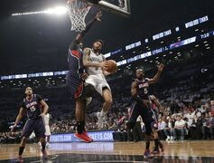 Atlanta Hawks forward Paul Millsap, second from left, defends as Brooklyn Nets guard Deron Williams (8) goes up for a layup in the first quarter of Game 4 of a first round NBA playoff basketball game, Monday, April 27, 2015, in New York. (AP Photo/Kathy Willens)