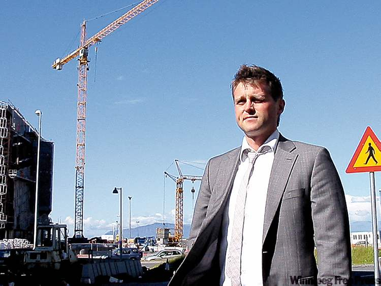 Tomas Brynjolfsson worked at Landsbanki, one of Iceland's three banks that collapsed. Now he's an economist with the country's finance department. The cranes on Reykjavik streets work at government-financed projects only. All other construction projects halted when the nation went bankrupt.