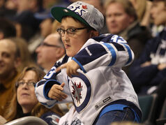 A Winnipeg Jets fan has fun during second period play against the Florida Panthers at the MTS Centre.