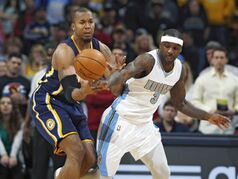 Indiana Pacers forward David West, left, reaches out for a loose ball with Denver Nuggets guard Ty Lawson in the first quarter of an NBA basketball game Saturday, Dec. 20, 2014, in Denver. (AP Photo/David Zalubowski)