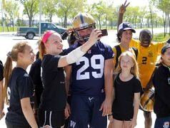 After Day 1 of Bombers rookie camp, Jr. High kids from Louis Riel meet new  Bombers #29 Garrett Waggoner.