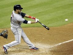 Cleveland Indians' Mike Aviles hits a bases-loaded sacrifice fly to bring in Jose Ramirez in the 13th inning of a baseball game against the Houston Astros Thursday, Sept. 18, 2014, in Houston. (AP Photo/Pat Sullivan)