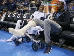 Oklahoma City Thunder guard Russell Westbrook, left, talks with teammate Kevin Durant before the Thunder's preseason NBA basketball game against the Utah Jazz in Oklahoma City, Tuesday, Oct. 21, 2014. (AP Photo/Sue Ogrocki)