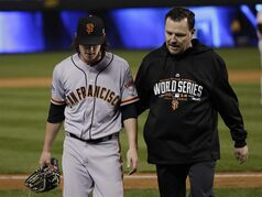 San Francisco Giants pitcher Tim Lincecum is escorted off the field during the eighth inning of Game 2 of baseball's World Series against the Kansas City Royals Wednesday, Oct. 22, 2014, in Kansas City, Mo. (AP Photo/Matt Slocum)