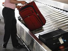One reason we're all trying to pound our bags into that space is to avoid baggage fees.