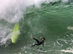 A person surfs at the Wedge in Newport Beach, Calif., Monday, May 4, 2015. The highest surf was expected Monday, with some sets reaching more than 12 feet along beaches in Orange and San Diego counties and 10 feet at Malibu and Zuma in Los Angeles County, the National Weather Service said. (Mindy Schauer/The Orange County Register via AP) MAGS OUT; LOS ANGELES TIMES OUT; MANDATORY CREDIT