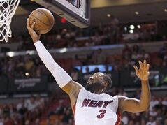 CORRECTS DAY OF WEEK - Miami Heat guard Dwyane Wade (3) leaps to score against the Detroit Pistons in the first half of an NBA basketball game, Sunday, March 29, 2015, in Miami. (AP Photo/Joe Skipper)