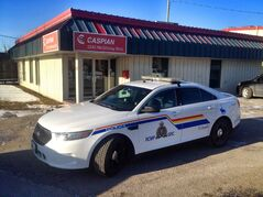 An RCMP vehicle outside the offices of Caspian Construction Wednesday. Caspian is the firm in charge of the renovation of the new Winnipeg Police Service headquarters.