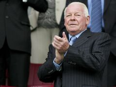 FILE - This is a Sunday Aug. 14 2005 file photo of Wigan Athletic chairman Dave Whelan as he applauds his team as they prepare to take on Chelsea in the club,s first English Premiership soccer match at The JJB Stadium, Wigan, England. Whelan resigned as chairman of second tier English club Wigan on Tuesday March 3, 2015. (AP Photo/Paul Ellis, File)