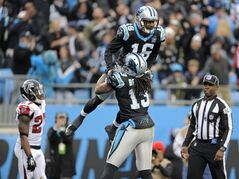Carolina Panthers' Philly Brown (16) celebrates his touchdown catch with teammate Kelvin Benjamin (13) as Atlanta Falcons' Robert McClain (27) walks to the sideline in the second half of an NFL football game in Charlotte, N.C., Sunday, Nov. 16, 2014. (AP Photo/Mike McCarn)