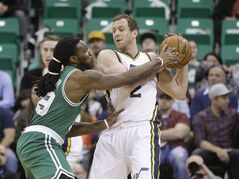 Boston Celtics forward Jae Crowder (99) defends against Utah Jazz forward Joe Ingles (2) in the first quarter during an NBA basketball game Monday, Jan. 26, 2015, in Salt Lake City. (AP Photo/Rick Bowmer)