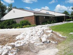 Last month's extremely high water levels along the Assiniboine River in the RMs of Cartier, St. Francois Xavier and Headingley prompted an emergency sandbagging effort to protect properties such as the Schoenfelder Mennonite Church.
