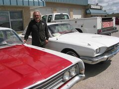 Wayne Boonstra shows off the 1969 Ranchero and 1966 Thunderbird that he's planning on restoring.