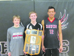 Sports stars (l-r) Dillon Lambkin, Colby Grass and Theo (whose last name cannot be published) helped Hedges Middle School win championships in both volleyball and basketball this season.