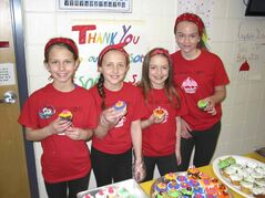 From left: Katelyn, Katrina, Ella and Madi moments before their cupcake sale at Island Lakes Community School.