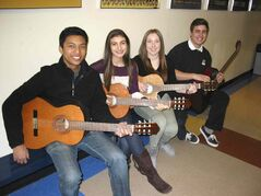 From left to right: Limhi Visaya, Georgia Andromidas, Rachel Robinson and Matthew Kobewka pictured with their guitars at J. H. Bruns Collegiate.
