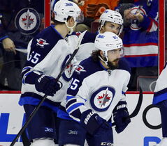 Winnipeg Jets' Mathieu Perreault (85) looks up at the replay board after scoring a goal in the first period Thursday.