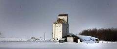 Clanwilliam's century-old, two-sheet curling rink sits nearly buried in snow in the shadow of a long-abandoned elevator.