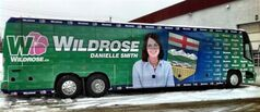 The newly-covered Wildrose Party campaign bus showing leader Danielle Smith is shown in a photo taken from the social media website Twitter. Alberta's Wildrose party campaign bus is back on the road, this time without the tire cleavage. THE CANADIAN PRESS/HO-Twitter