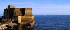 This May 1, 2014 photo shows a view of Castel dell' Ovo at sunset in Naples, Italy. This well-known landmark on the Bay of Naples is one of the places you can visit for free in Italy's third-largest city. (AP Photo/Michelle Locke)