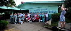 Winnipeg's team 'Op-Walk' gathers for a portrait in front of Managua's Hospital Escuela Dr. Roberto Calderon Gutierrez, a public teaching hospital where care is provided by the government.