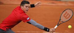 Canada's Milos Raonic returns in the fourth round match of the French Open tennis tournament against Spain's Marcel Granollers at the Roland Garros stadium, in Paris, France, Sunday, June 1, 2014. Raonic won in three sets 6-3, 6-3, 6-3. (AP Photo/Michel Spingler)