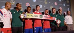 Bayern coach Pep Guardiola, left to right, MLS all-star Thierry Henry, Bayern Munich's Julian Green, Robert Lewandowski and Franck Ribery, MLS all-stars Matt Besler and Clint Dempsey and MLS all-stars coach Caleb Porter pose for a photo at a photo op in Portland, Ore., on Monday, Aug. 4, 2014. THE CANADIAN PRESS/Neil Davidson