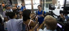 Sung Woo Lee, center, speaks to the local media after arriving at Kansas City International Airport Tuesday, Aug. 5, 2014 in Kans City, Mo. . Sung Woo Lee is a Kanas City Royals fan from South Korea and came to Kansas City to see his first Royals game. He will see five games and throw out the first pitch on Monday (AP Photo/The Kansas City Star, Brian Davidson) (ONLN OUT; IONLN OUT - MBI). (Brian Davidson / Special to the Star)