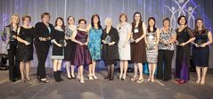 Winners of the Women of Distinction Awards in 2012. (L-R) Karen Botting, Dr. Maureen Heaman, Janice Lukes, Anna-Celestrya Carr, Catharine Teichroew, Dr. Jeannette Montufar, Diane Redsky, Joy Smith, Dianna Bussey, Kelby Loeppky, Dr. Chau Pham, Wendy Furst (representing daughter Amanda Furst), Tina Chen & Alana Robert.