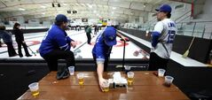 They'll drink to this - the Carberry bonspiel is a success story in the rural curling world.  Mike Reykdal, Scott Witherspoon and Warren Birch quench their thirst.