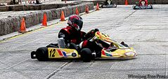 John Buzza (#12) drifts to victory in a karting race at Gimli Motorsport Park.