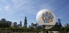 FILE - This Aug. 4, 2013 file photo shows a Lollapalooza balloon at the Lollapalooza Festival in Grant Park in Chicago. Lollapalooza marks its 10th anniversary in Chicago when it opens for three days starting Friday, Aug. 1, 2014, with a lineup including Eminem, Outkast and Kings of Leon. Lollapalooza became the basis for the modern festival culture and circuit that has evolved since, including events like Bonnaroo, Coachella and a legion of smaller multi-day parties. (AP Photo/Scott Eisen, File)