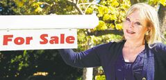 Candy Spelling, wife of the late TV producer Aaron Spelling, is shown in front of a generic �For Sale� sign taken to promote her HGTV special Selling Spelling Manor.