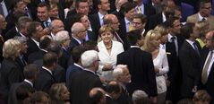 German Chancellor Angela Merkel stands between other lawmakers as she waits to casts her vote about the European Stability Mechanism (ESM) at the parliament Bundestag in Berlin, Friday, June 29, 2012. (AP Photo/Markus Schreiber)
