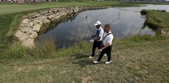 Tiger Woods, left, walks on the seventh hole with his swing coach Sean Foley during a practice round for the PGA Championship golf tournament at Valhalla Golf Club on Wednesday, Aug. 6, 2014, in Louisville, Ky. The tournament is set to begin on Thursday. (AP Photo/David J. Phillip)