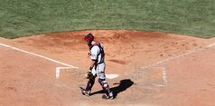Minnesota Twins catcher Eric Fryer heads to the clubhouse as Boston Red Sox's Mike Napoli rounds the bases after hitting the game-winning, walk off in the 10th inning of a baseball game at Fenway Park in Boston, Wednesday, June 18, 2014. The Red Sox won 2-1. (AP Photo/Charles Krupa)