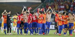 Chilean players celebrate at the end of the group B World Cup soccer match between Chile and Australia in the Arena Pantanal in Cuiaba, Brazil, Friday, June 13, 2014. Chile won the match 3-1. (AP Photo/Frank Augstein)