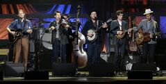 FILE - This Sept. 18, 2013 file photo shows, from left, Chance McCoy, Ketch Secor, Morgan Jahnig, Critter Fuqua, Cory Younts and Gill Landry from Old Crow Medicine Show performing during the Americana Music Honors and Awards Show in Nashville, Tenn. The band had their biggest hit of their career by adapting an unfinished Bob Dylan song into