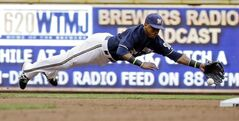 Milwaukee Brewers shortstop Jean Segura makes a diving try at a single hit by Colorado Rockies' Michael McKenry during the third inning of a baseball game Friday, June 27, 2014, in Milwaukee. (AP Photo/Morry Gash)